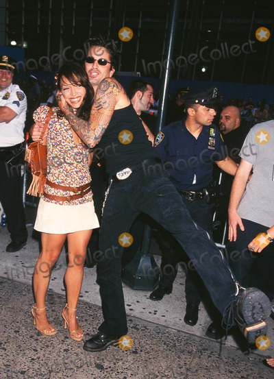 """Tommy Lee Photo - Photo by: Walter WeissmanSTAR MAX, Inc. - copyright 2001. 8/1/01Tommy Lee with date at """"MTV20: Live and Almost Legal"""".(Hamerstein Ballroom, NYC)"""