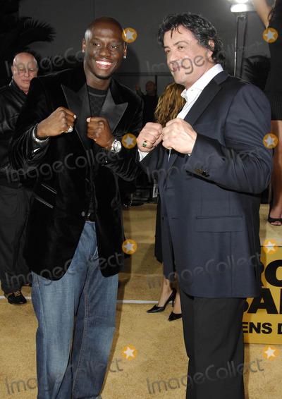 "Antonio Tarver, Sylvester Stallone Photo - Photo by: Michael Germana/starmaxinc.com2006. 12/13/06Antonio Tarver and Sylvester Stallone at the premiere of ""Rocky Balboa"".(Hollywood, CA)"