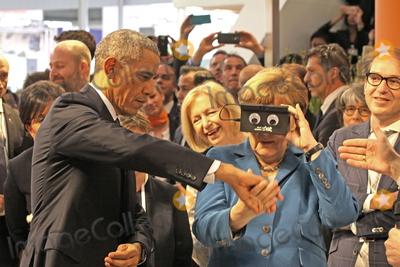 Angela Merkel, Barack Obama, President Barack Obama Photo - US-President BARACK OBAMA and German chancellor ANGELA MERKEL testing virtual reality goggles when touring the Hannover Messe, Hannover, 25.04.2016