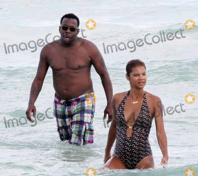 Alicia Etheridge, Bobbi Brown, Bobby Brown, Dri Photo - Singer Bobby Brown takes a dip in the warm Miami Beach ocean with his fiancee Alicia Etheridge.  After spending time in the water the couple walked to shore and dried off with beach towels. Miami, FL. 09/26/10.