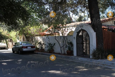 Demi Lovato, DEMI  LOVATO Photo - EXCLUSIVE!! Exterior views of 18-year-old actress and singer Demi Lovato's new home in Sherman Oaks that was reportedly purchased for $2.25 million.  The 1928 Spanish style house boasts four bedrooms, four and a half bathrooms and just over 4000 square feet of living space.  The purchase comes during a seemingly difficult time in the Disney star's life as Lovato is currently seeking treatment in a rehabilitation clinic to cope with, 'emotional and physical issues'. Los Angeles, CA. 11/13/10.Fees must be agreed prior to publication.