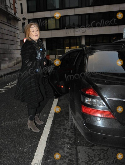 Adele, Adele Adkins, Dermot O'Leary, Grammy Awards Photo - Singer Adele (aka Adele Adkins) arrives, big water bottle in hand, at the studios of BBC Radio where she promoted her upcoming second studio album '21'.  The Grammy Award winner appeared to have driven herself and gave a modest smile as she walked inside where she performed a live session on the Dermot O'Leary show. London, UK. 01/22/11.