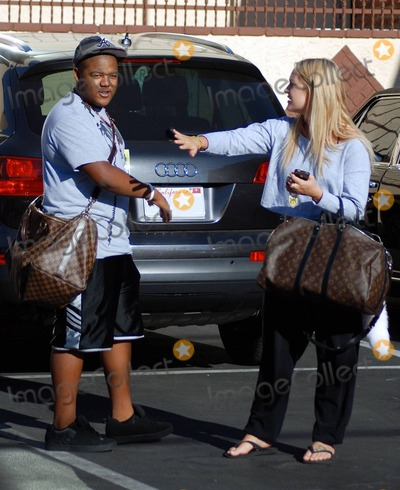 """Kyle Massey Photo - Kyle Massey and Lacey Schimmer carry similar Louis Vuitton duffel bags as they leave the """"Dancing with the Stars"""" studios after rehearsals for the upcoming season of the show which premieres September 20. Los Angeles, CA. 9/5/10."""