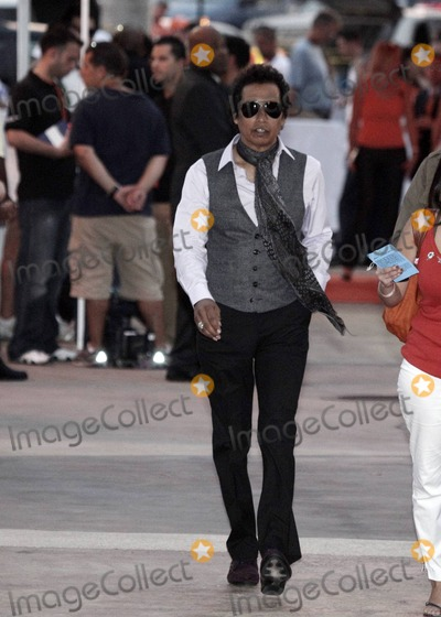 Alejandro Escovedo Photo - American singer-songwriter Alejandro Escovedo walks the orange carpet at the Miami Dolphins vs. New York Jets NFL game held at Sun Life Stadium. Miami, FL. 09/26/10.