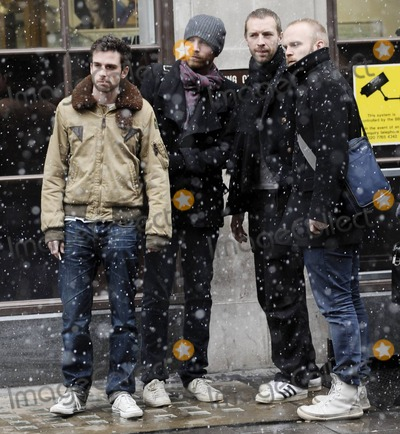 """Chris Martin, Coldplay, Guy Berryman, Gwyneth Paltrow, Jonny Buckland, Will Champion, Christmas Lights Photo - UK band Coldplay look in lively spirits as they stand outside BBC Radio studios during a snowy afternoon.  The group, Chris Martin, Jonny Buckland, Guy Berryman and Will Champion, appeared on BBC 1's """"Live Lounge"""" where they performed their single Christmas Lights. The group will be performing two 'Crisis Hidden Gig' shows with The Choir with No Name before Christmas in Liverpool and Newcastle.  The BBC appearance comes on the heels of news that two songs performed by Martin's wife, Oscar winning actress Gwyneth Paltrow, have been shortlisted for the 2011 Best Song Oscar, one of which, Me and Tennessee, was written by Chris. London, UK. 12/17/10."""