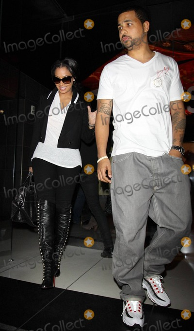 """Alani Vazquez, Christian Louboutin, Ciara, Eve, LaLa, """"LaLa"""" Vazquez, LaLa Vazquez Photo - In stellar Christian Louboutin knee-high lace up leather boots former MTV veejay, actress and television personality Lala Vazquez (aka Alani Vazquez) gets a helping hand from a friend as they leave Katsuya restaurant.  R&B singer Ciara wore the same pair of boots just a couple of weeks ago to a Christmas Eve basketball game. Los Angeles, CA. 01/06/11."""