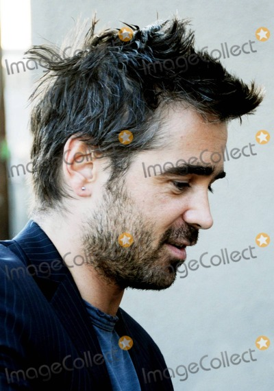 """Alicja Bachleda, Colin Farrell, Jimmy Kimmel, Ondine, The Doors Photo - Irish bad boy, actor Colin Farrell arrives via the back door at the """"Jimmy Kimmel Live!"""" studio to appear on the ABC talk show.  Farrell, 34, was at the show to promote his latest film """"Ondine"""", a drama that was filmed in Farrell's home country and is being released in the U.S. on June 4th.  The Golden Globe and IFTA award winner happily signed autographs, posed for photos with fans and despite looking a bit scruffy with his messy hair and beard, looked sharp in a pinstriped jacket.  Farrell, who is dating his """"Ondine"""" co-star, actress Alicja Bachleda, wore a ring on his wedding ring finger. Los Angeles, CA. 06/03/10."""