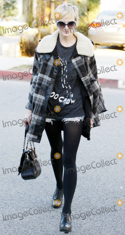 Ashlee Simpson, Ashlee Simpson Wentz, Ashlee Simpson-Wentz, Bel-Air, Nicole Richie, Pixies, Hüsker Dü Photo - Ashlee Simpson-Wentz shows off her recently cropped pixie hairdo as she leaves a West Hollywood salon where she got her blonde do touched up and met with soon to be married Nicole Richie.  Ashlee, who will reportedly be one of 75 guests at Nicole's very exclusive and secretive Bel Air wedding, looked very happy as she left the salon.  Ashlee also looked very fashionable, and very slim, in her trendy plaid winter jacket, black nylons with denim cutoff shorts, lace up heels and worn tee. Los Angeles, CA. 12/09/10.