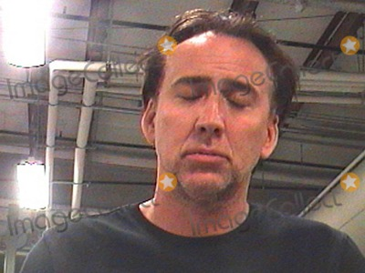 "Alice Kim Cage, Alice Kim, Nicolas Cage, The Police Photo - The booking photo of actor Nicolas Cage after he was arrested around 6am this morning in New Orleans on charges of domestic abuse.  According to reports Cage, who is currently filming the movie ""Medallion"" in the city, and his wife of seven years Alice Kim Cage had a disagreement about which apartment they were staying at and reportedly Nicolas grabbed Alice by the arm.  Reports go on to say that Cage apparently dared the police to arrest him, reportedly saying, 'Why don't you just arrest me?' Cage's bail was reportedly set at $11,000 and according to reports he was later released around 11am. New Orleans, LA. 04/16/11."