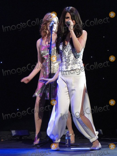 Gomez, Selena Gomez Photo - Selena Gomez hops about stage in a cute white outfit as she perform live during KIIS Jingle Ball 2010 held at the Nokia Theatre.  Los Angeles, CA. 12/05/10.