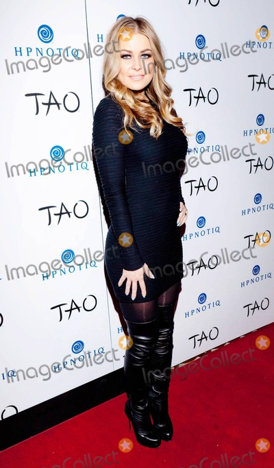Carmen Electra, Go Go's, Go Gos, Go-Go's, Go-Gos Photo - Carmen Electra wears a sheer ribbed bodycon mini dress paired with knee-high black leather boots at Tao Nightclub inside the Venetian Resort Hotel Casino where she played host to the 5th annual Tao A Go Go contest. Las Vegas, NV. 01/27/11