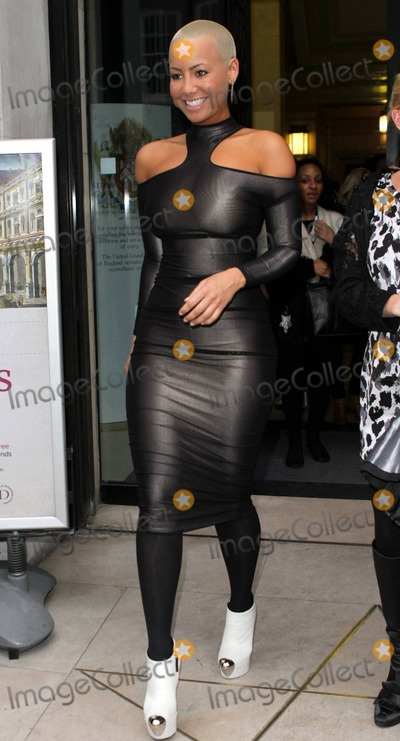 Photos And Pictures Amber Rose Wears A Tight Form Fitting Black