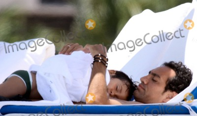 Alessandro Nesta Photo - EXCLUSIVE!! World Cup-winning Italian soccer star Alessandro Nesta spends a family day at the beach with wife Gabriela Pagnozzi, daughter Sofia and son Tommaso. The family seemed to enjoy a relaxing day together and Alessandro held little Tomasso on his chest while he slept. Nesta, who plays as a defender for Serie A club Milan is considered by many as one of the best centre backs to have ever played and is a four-time member of the aunnual UEFA Team of the Year.