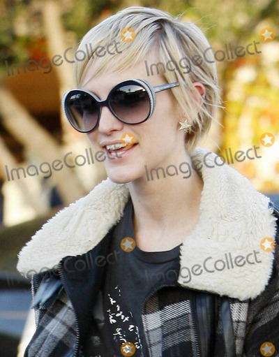 Ashlee Simpson, Ashlee Simpson Wentz, Ashlee Simpson-Wentz, Bel-Air, Nicole Richie, Pixies Photo - Ashlee Simpson-Wentz shows off her recently cropped pixie hairdo as she leaves a West Hollywood salon where she got her blonde do touched up and met with soon to be married Nicole Richie.  Ashlee, who will reportedly be one of 75 guests at Nicole's very exclusive and secretive Bel Air wedding, looked very happy as she left the salon.  Ashlee also looked very fashionable, and very slim, in her trendy plaid winter jacket, black nylons with denim cutoff shorts, lace up heels and worn tee. Los Angeles, CA. 12/09/10.