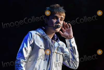 """Gomez, Justin Bieber, Rascal Flatts, Selena Gomez Photo - Teen heartthrob Justin Bieber performs live in concert at the O2 Arena on the day of his new video's release. The video, filmed with country superstars Rascal Flatts, is for the song """"That Should Be Me."""" According to recent reports, during Bieber's stay in Liverpool, UK, two female teenage fans broke into his hotel room. Reports say that the girls slipped in the hotel's side entrance, stole housekeeping outfits and headed to Bieber's room where they were admitted by staff after calling 'housekeeping' at his door. They were discovered after they began giggling while taking photos of Justin's belongings and trying to get into his bed and were evicted from the premises. Bieber, who wasn't there at the time, was reportedly furious about the incident and checked out of the hotel. In related news, it's reported that Selena Gomez confirmed her relationship with Justin today during a radio interview. London, UK. 3/14/11."""
