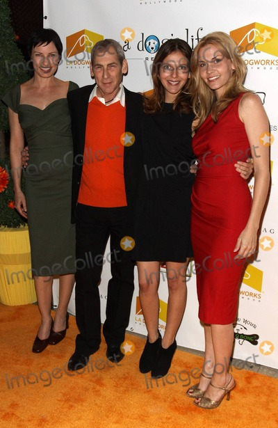 Allison Lange, Train Photo - Andrew Rosenthal, owner of LA Dogworks, with Julia Pennington (L) and Allison Lange (far R) pose on the orange carpet during the second annual 'A Night of Emotion' fundraiser benefiting A Dog's Life Rescue held at LA Dogworks, a dog daycare, boarding, training and grooming shop. Los Angeles, CA. 02/03/11.