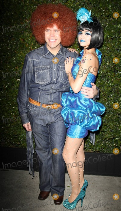 Gomez, Perez Hilton, Selena Gomez, Anna Maria Perez de Taglé Photo - Dressed in a wacky fringe denim outfit and a big afro wig celebrity blogger Perez Hilton and Selena Gomez, dressed in a shimmering blue dress with blue sparkle heels, a feathered hairband and blue lipstick, arrive at Hilton's Blue Ball Birthday Celebration and blue-themed dress up party held at Siren Studios to celebrate his 33rd birthday.  Los Angeles, CA. 03/26/11.
