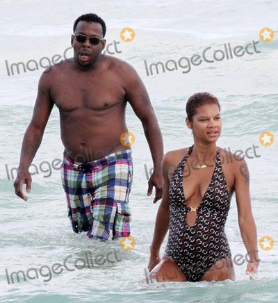 Alicia Etheridge, Bobbi Brown, Bobby Brown Photo - Singer Bobby Brown takes a dip in the warm Miami Beach ocean with his fiancee Alicia Etheridge. Miami, FL. 09/26/10.