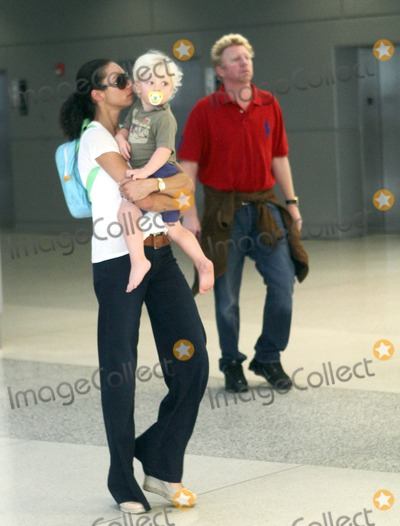 Adored, Boris Becker, The Used, Lilly Kerssenberg Photo - Boris Becker makes his way through Miami International Airport with his adorable blonde son Amadeus, now 18 months old, and his wife Sharlely. The family are in town to help celebrate Elias Becker's 12th birthday tomorrow. Boris, who is also planning a trip to New York for the US open, appeared to be limping as the family strolled through the terminal. Miami, FL. September 3rd 2011.