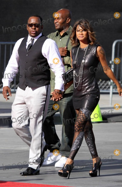Alicia Etheridge, Bobbi Brown, Bobby Brown Photo - Bobby Brown gives the peace sign and holds his girlfriend Alicia Etheridge's hand as they arrive at the red carpet for the 2010 ESPY Awards held at Nokia Theatre L.A. Live. Los Angeles, CA. 07/14/10.