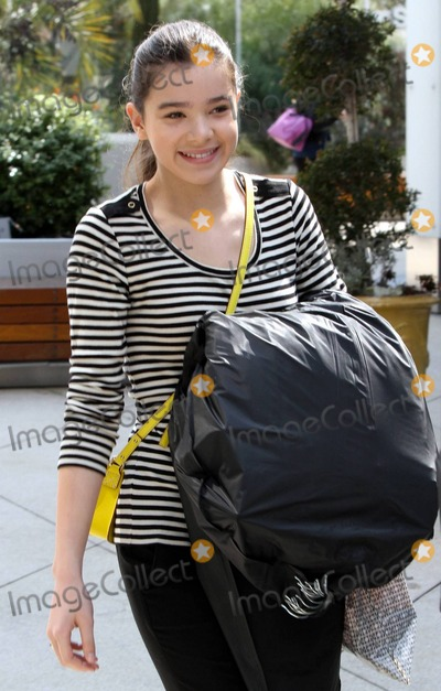 """At Last, Grits, Hailee Steinfeld Photo - EXCLUSIVE!! Nominee for Best Actress at last week's Academy Awards, Hailee Steinfeld gets in some shopping at the H&M showroom. Hailee, who was nominated for her role in the film """"True Grit,"""" was all smiles as she left carring a garment bag full of clothing. West Hollywood, CA. 3/3/11.Fees must be agreed prior to publication."""