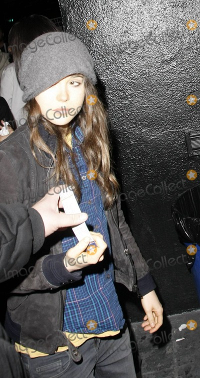 Ellen Page, The Darkness Photo - Juno star Ellen Page arrives wearing a plaid shirt, black jacket and hat to Roxy Theatre for the Deep Dark Robot Concert. Los Angeles, CA. 04/21/11