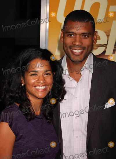 "Allan Houston Photo - Allan Houston and Wife Tamara Arriving at the Premiere of Warner Bros. Pictures' ""the Informant!"" at the Ziegfeld Theatre in New York City 09-15-2009. Photo by Henry Mcgee-Globe Photos, Inc. 2009."