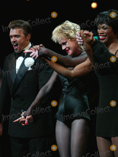 "Melanie Griffith, Brent Barrett, Melanie Griffiths Photo - Melanie Griffith Takes Her Curtain Call As Roxie Hart with Brent Barrett and Deidre Goodwin in ""Chicago"" at the Ambassador Theatre in New York City on July 20, 2003. Photo Henry Mcgee/Globe Photos, Inc. 2003."