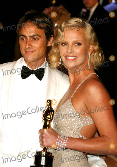 Charlize Theron, Stuart Townsend Photo - Stuart Townsend and Charlize Theron at Vanity Fair Oscar Party at Mortons in West Hollywood, CA on February 29, 2004. Photo by Henry Mcgee/Globe Photos, Inc. 2004.