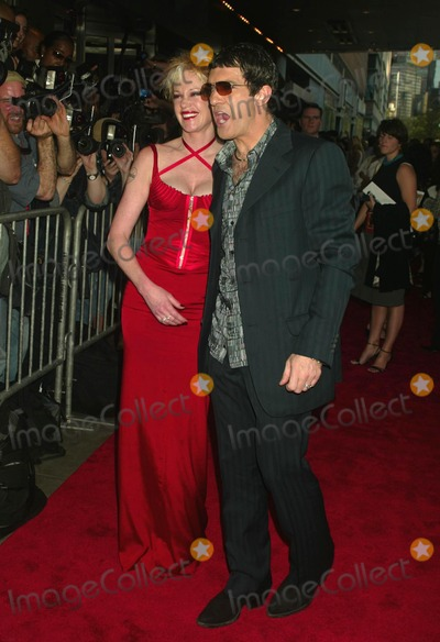 """Antonio Banderas, Melanie Griffith, Melanie Griffiths Photo - Melanie Griffith and Antonio Banderas at the Premiere of """"Once Upon a Time in Mexico"""" at Loews Lincoln Square in New York City on September 7, 2003. Photo Henry Mcgee/Globe Photos, Inc. 2003."""