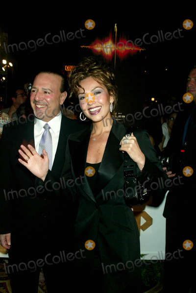"""Thalia, Celine Dion, Dion, Tommy Mottola Photo - Tommy Mottola and Thalia at Opening Night of """"a New Day..."""" Featuring Celine Dion at the Colosseum at Caesars Palace in Las Vegas, Nevada on March 25, 2003. Photo Henry Mcgee/Globe Photos, Inc. 2003"""