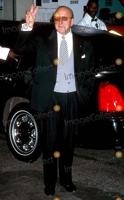Clive Davis, David Gest, Liza Minnelli Photo - Sd03162002 Liza Minnelli & David Gest Wedding Reception at the Regent Wall Street, New York City Photo: Henry Mcgee/ Globe Photos Inc. 2002 Clive Davis