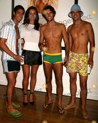April Wilkner Photo - Andre Resende, April Wilkner, Daniel Bueno, and Carlos Bokelman at H&m's Sizzling Swimsuit Event at H&m Soho Loft in New York City on May 12, 2004. Photo by Henry Mcgee/Globe Photos, Inc. 2004.