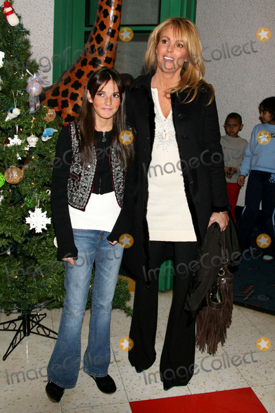 Dina Lohan, Ali Lohan, Ronald McDonald, Ali Farka Touré Photo - Ali Lohan with Her Mother Dina Lohan Signing Copies of Her New Cd Totally Awesome Christmas at the Ronald Mcdonald House of New York in New York City on 12-07-2005. Photo by Henry Mcgee/Globe Photos, Inc. 2005.