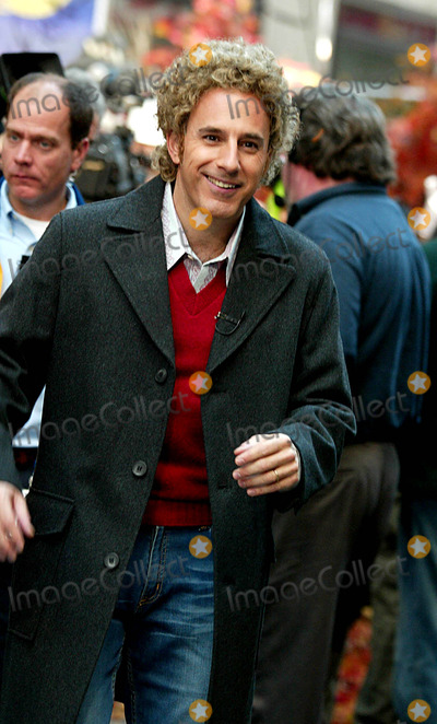 Matt Lauer, Art Garfunkel Photo - Matt Lauer (Dressed As Art Garfunkel) at Nbc's Today Show Annual Halloween Contest in Rockefeller Plaza at the NBC Studios on October 31, 2003. Photo Henry Mcgee/Globe Photos, Inc. 2003.