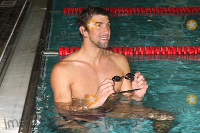 Apolo Anton Ohno, Michael Phelps, Train Photo - Michael Phelps Shows His Support to Apolo Anton Ohno During a Training Session at the Sports Center at Chelsea Piers in New York City on 09-27-2011 to Prepare Ohno For the Ing NYC Marathon in November. Photo by Henry Mcgee-Globe Photos, Inc. 2011.