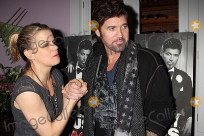"""Amy Spanger, Billy Ray, Billy Ray Cyrus Photo - Billy Ray Cyrus with Co-star Amy Spanger Arriving at the After-party to Celebrate His Broadway Debut in the Musical """"Chicago"""" at Victor's Cafe in New York City on 11-05-2012. Photo by Henry Mcgee-Globe Photos, Inc. 2012."""
