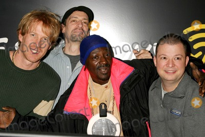 Flava, Flava Flav, Anthony Cumia, Jim Norton, Opie and Anthony, Group Shot Photo - Flava Flav with Opie Hughes, Anthony Cumia and Jim Norton on Xm Satellite Radio's Opie and Anthony at Xm's Studios in New York City on 02-10-2005. Photo by Henry Mcgee/Globe Photos, Inc. 2005.
