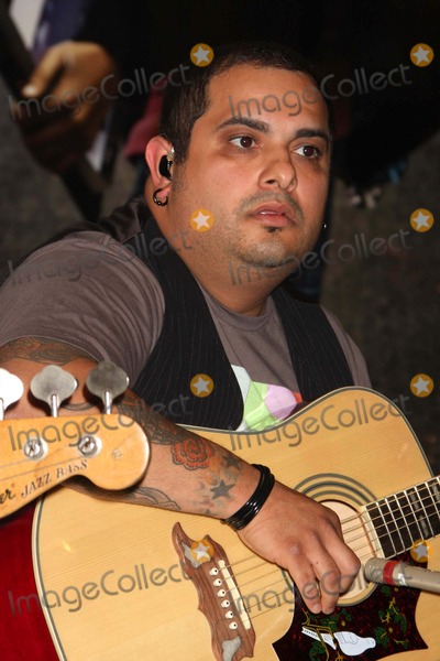 "Taking Back Sunday Photo - Eddie Reyes of Taking Back Sunday Performing From Their New Album ""New Again"" to Celebrate to Launch of New Clothing Brand D'coded at Macy's Herald Square in New York City on 08-16-2009. Photo by Henry Mcgee-Globe Photos, Inc. 2009."