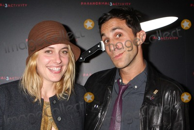 """Greta Gerwig, Ariel Schulman Photo - Greta Gerwig and Director Ariel Schulman Arriving at a Super Fan Screening of """"Paranormal Activity 3"""" at Regal Union Square Stadium 14 in New York City on 10-18-2011. Photo by Henry Mcgee-Globe Photos, Inc. 2011."""