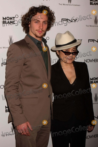 """Yoko Ono, Aaron Johnson Photo - Aaron Johnson and Yoko Ono Arriving at the Premiere of the Weinstein Company's """"Nowhere Boy"""" at the Tribeca Performing Arts Center in New York City on 09-21-2010. Photo by Henry Mcgee-Globe Photos, Inc. 2010."""