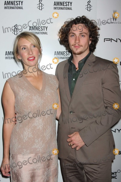 """Aaron Johnson, Sam Taylor-Wood, Sam Taylor Photo - NYC  09/21/10Aaron Johnson (20 year old star of Kick-Ass) and fiance director Sam Taylor-Wood (43 years old) at a screening of their new movie """"Nowhere Boy"""" at the Tribeca Performing Arts CenterPhoto by Adam Nemser-PHOTOlink.net"""