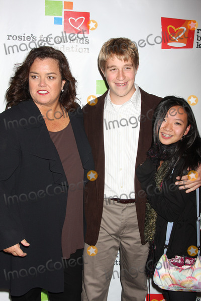 """Rosie O'Donnell, Latifah, Queen, Queen Latifah, ROSIE ODONNELL Photo - NYC  11/23/09Rosie O'Donnell with son Parker O'Donnell (14 years old) and his girlfriend Sabine at """"Rosie's Broadway Kids"""" sponsored by Rosie's For All Kids, honoring Queen Latifah, at the Palace TheatreDigital Photo by Adam Nemser-PHOTOlink.net"""