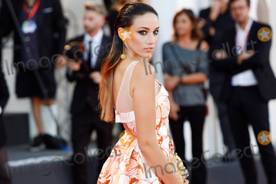 """Photo - VENICE, ITALY - SEPTEMBER 4: Delphine Wespiser walks the red carpet ahead of the """"Lan Xin Da Ju Yuan"""" (Saturday Fiction) screening during the 76th Venice Film Festival at Sala Grande on September 04, 2019 in Venice, Italy.(Photo by Laurent Koffel/ImageCollect.com)"""