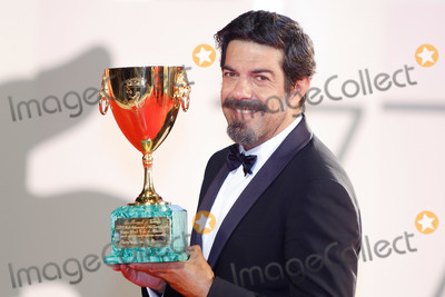 Pierfrancesco Favino Photo - VENICE, ITALY - SEPTEMBER 12: Pierfrancesco Favino poses with the Coppa Volpi for Best Actor during the winners photocall at the 77th Venice Film Festival on September 12, 2020 in Venice, Italy.   