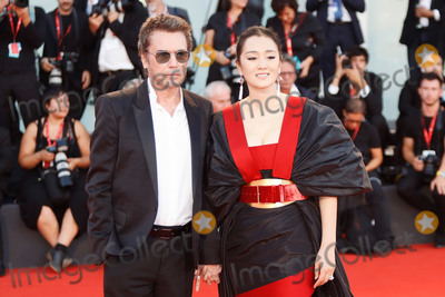 "Gong Li, Jean Michel Jarre, Jean-Michel Jarre Photo - VENICE, ITALY - SEPTEMBER 4: Jean-Michel Jarre and Gong Li walk the red carpet ahead of the ""Lan Xin Da Ju Yuan"" (Saturday Fiction) screening during the 76th Venice Film Festival at Sala Grande on September 04, 2019 in Venice, Italy.