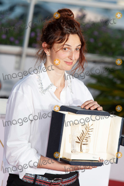 ATL, Alice Rohrwacher Photo - CANNES, FRANCE - MAY 19: Italian director Alice Rohrwacher poses with her trophy on May 19, 2018 during a photocall after she jointly won the Best Screenplay prize for the film 'Lazzaro Felice (Happy as Lazzaro)' atl the Palme D'Or Winner during the 71st annual Cannes Film Festival at Palais des Festivals on May 19, 2018 in Cannes, France. (Photo by Laurent Koffel/ImageCollect.com)
