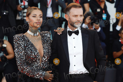 "Hüsker Dü Photo - VENICE, ITALY - SEPTEMBER 4: Zoe Cristofari and Massimo Fasoli walk the red carpet ahead of the ""Lan Xin Da Ju Yuan"" (Saturday Fiction) screening during the 76th Venice Film Festival at Sala Grande on September 04, 2019 in Venice, Italy.