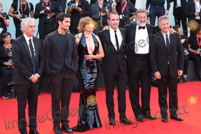 """Alain Goldman, Emmanuelle Seigner, Jean Dujardin, Louis Garrel, Luca Barbareschi Photo - VENICE, ITALY - AUGUST 30: (L-R) Alain Goldman, Louis Garrel, Emmanuelle Seigner, Jean Dujardin, Luca Barbareschi and Paolo Del Brocco walk the red carpet ahead of the """"J'Accuse"""" (An Officer And A Spy) screening during the 76th Venice Film Festival at Sala Grande on August 30, 2019 in Venice, Italy.(Photo by Laurent Koffel/ImageCollect.com)"""