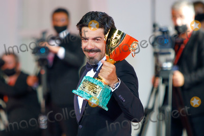 Pierfrancesco Favino Photo - VENICE, ITALY - SEPTEMBER 12: Pierfrancesco Favino poses with the Coppa Volpi for Best Actor during the winners photocall at the 77th Venice Film Festival on September 12, 2020 in Venice, Italy.   (Photo by Laurent Koffel/ImageCollect.com)